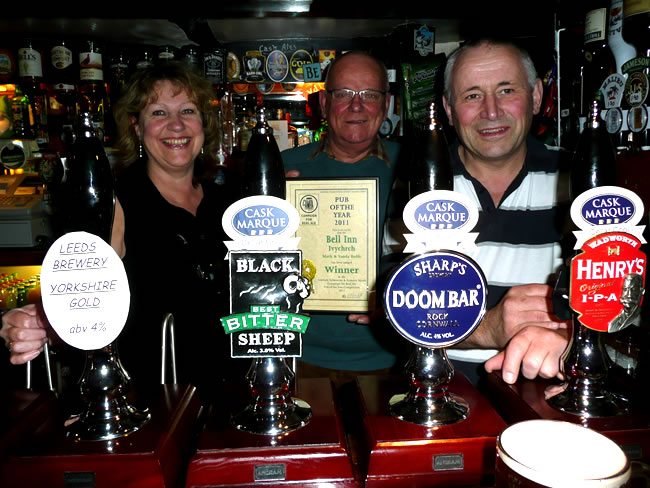 Mark and Vanda with CAMRA Branch Pubs Officer Bob Martin